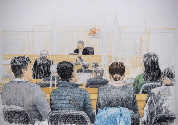 In this courtroom sketch, Meng Wanzhou, back right, the CFO of Huawei Technologies, listens during a bail hearing at B.C. Supreme Court in Vancouver, on Tuesday Dec. 11, 2018. Her husband Liu Xiaozong is seen seated at front left.
