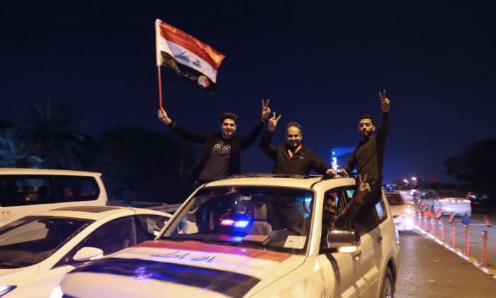 Iraqis celebrate the re-opening of the Green Zone, home to government buildings and Western embassies, on Dec. 10, 2018 in the capital Baghdad. (Ahmad Al-Rubaye/AFP/Getty Images)