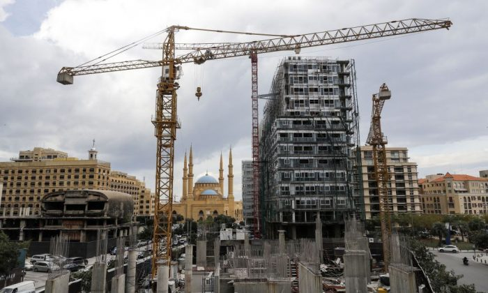 This picture taken on Nov. 26, 2018 shows a view of a halted construction site (foreground) and another still under construction (C) in the downtown district of the Lebanese capital Beirut, with the city's landmark Mohammad al-Amin mosque seen in the background. (Joseph Eid/AFP/Getty Images)