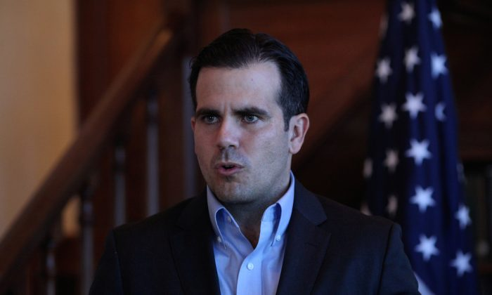Puerto Rico Governor Ricardo Rossello speaks during a Facebook live broadcast in the library of the governor's mansion, in San Juan, Puerto Rico, on Jan. 24, 2018. (Alvin Baez/File Photo/Reuters)
