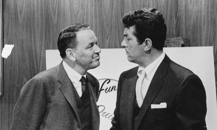 "Actor and singer Frank Sinatra with fellow performer Dean Martin  during filming. Both singers have performed the song ""Baby It's Cold Outside,"" with Martin's rendition being the most played version. (Keystone Features/Getty Images)"