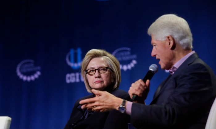 Former Secretary of State Hillary Clinton listens as former President Bill Clinton speaks during the annual Clinton Global Initiative conference at the University of Chicago in Chicago, Illinois on Oct. 16, 2018. (Joshua Lott/Getty Images)