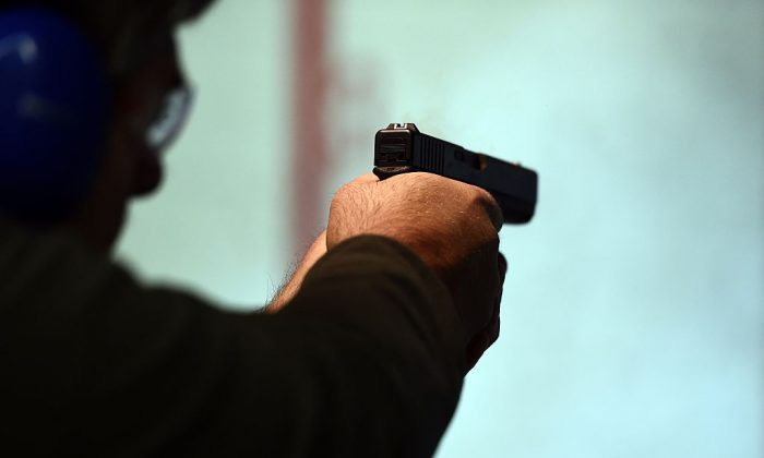 A retired police officer fires a gun at the Ultimate Defense Firing Range and Training Center in St Peters, Missouri, in a Nov. 26, 2014 file photo. (Jewel Samad/AFP/Getty Images)