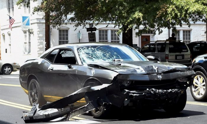 The silver Dodge Charger driven by James Alex Fields Jr. passes near the Market Street Parking Garage moments after driving into a crowd of counter-protesters on Water Street in Charlottesville, Va., on Aug. 12, 2017. Heather Heyer, 32 years old, was killed and 19 others injured when they were struck by Fields' car. (Matthew Hatcher/Getty Images)