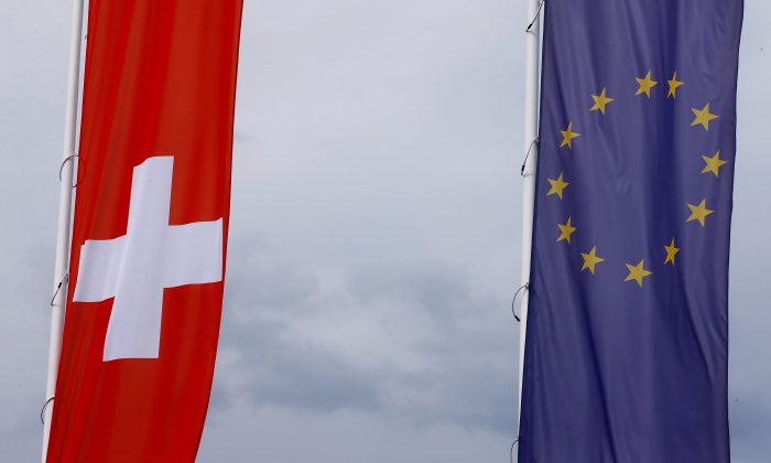 The flags of the European Union and Switzerland in Blotzheim, France, on June 27, 2017. (Reuters/Arnd Wiegmann/File Photo)