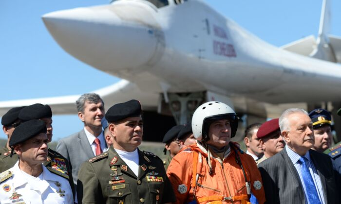 Venezuelan Defence Minister Vladimir Padrino (2-L) is pictured after the arrival of two Russian Tupolev Tu-160 strategic long-range heavy supersonic bomber aircrafts at Maiquetia International Airport, just north of Caracas, on Dec. 10, 2018. (Federico Parra/AFP/Getty Images)