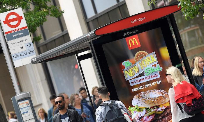 An electronic advertisement for a McDonalds food is seen at a bus stop on Oxford Street in London, Britain, May 11, 2018. (Reuters/Toby Melville)