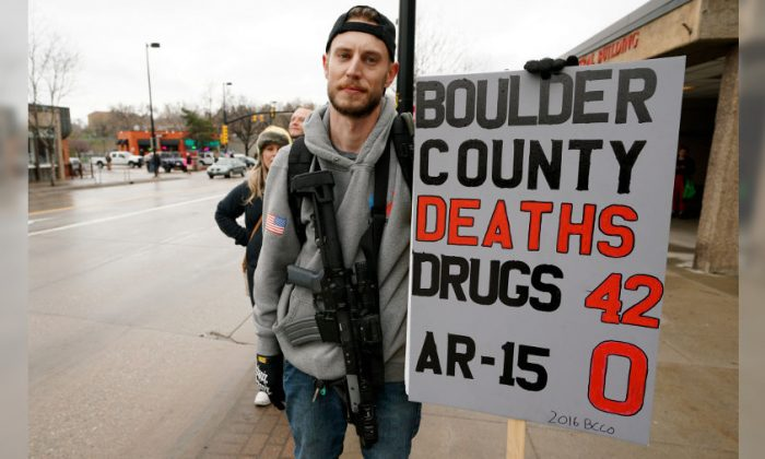 A man who didn't want to be identified at a protest against the looming gun ban in Boulder, Co., on April 21, 2018. (Rick T. Wilking/Getty Images)