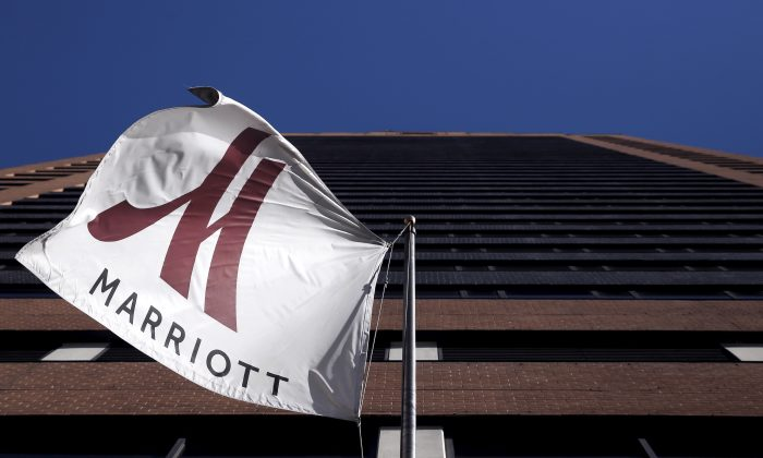 A Marriott flag hangs at the entrance of the New York Marriott Downtown hotel in New York City on Nov. 16, 2015.   (Reuters/Andrew Kelly)