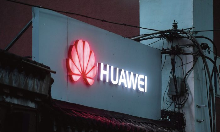 A Huawei sign outside a store in Beijing on Aug. 6, 2018. (GREG BAKER/AFP/Getty Images)
