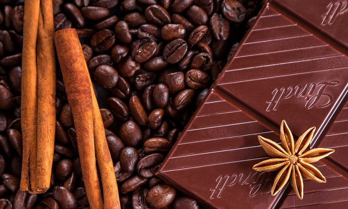 Adding cinnamon or dark chocolate to your coffee will help hold off a chill.