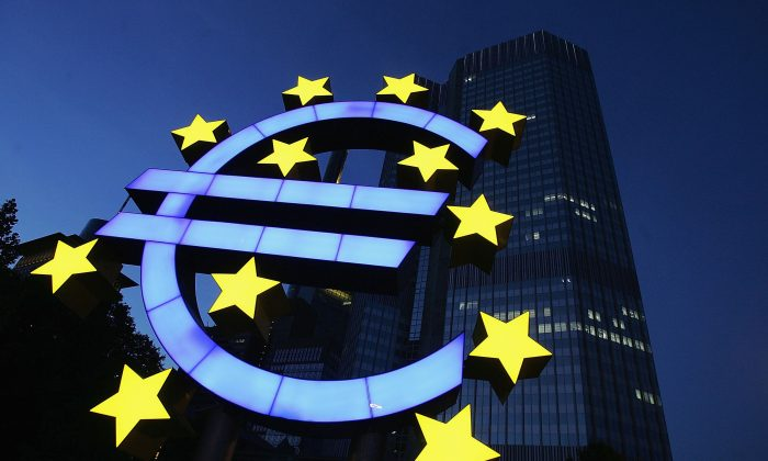 In this file photo a huge euro logo is seen in front of the headquarters of the European Central Bank (ECB) on June 13, 2005, in Frankfurt, Germany. The replacement of the national currency with a single euro was a political attempt to integrate the very different nations of the EU, according to some commentators. (Ralph Orlowski/Getty Images)