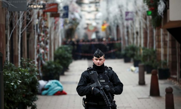 A French gendarme secures a street at the scene of a police operation the day after a shooting in Strasbourg, France, on Dec. 12, 2018. (Reuters/Christian Hartmann)