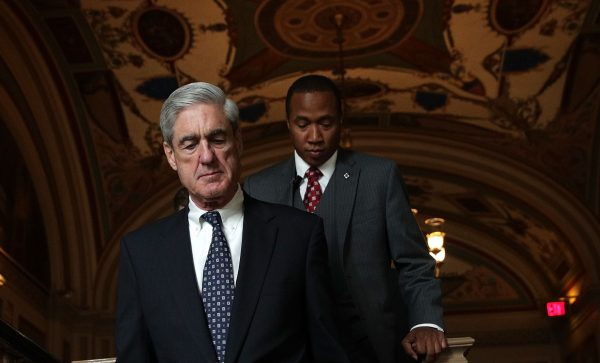 Special counsel Robert Mueller (L) arrives at the U.S. Capitol for closed meeting with members of the Senate Judiciary Committee in Washington