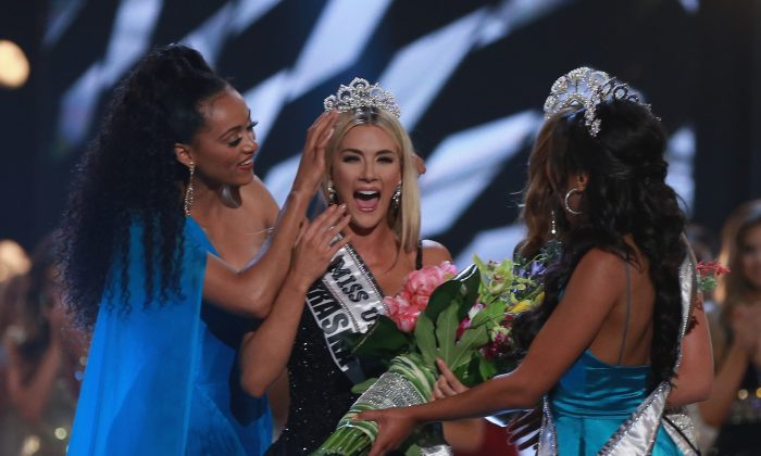 Miss Nebraska Sarah Rose Summers is crowned by Miss USA 2017 Kara McCullough, Miss Universe 2017 Demi-Leigh Nel-Peters, and Miss Teen USA 2018 Hailey Colborn, after winning the 2018 Miss USA Competition at George's Pond at Hirsch Coliseum in Shreveport, Louisiana, on May 21, 2018. (Matt Sullivan/Getty Images)