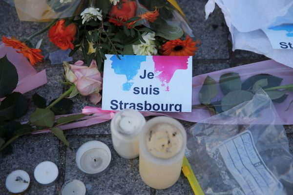 """The message """"I am Strasbourg"""" is seen among flowers and candles"""