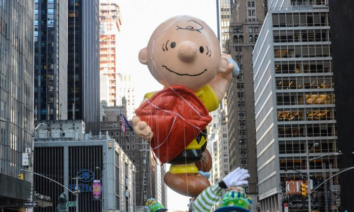 The Charlie Brown balloon floats on 6th Ave. during the annual Macy's Thanksgiving Day parade on Nov. 23, 2017 in New York City. (Stephanie Keith/Getty Images)