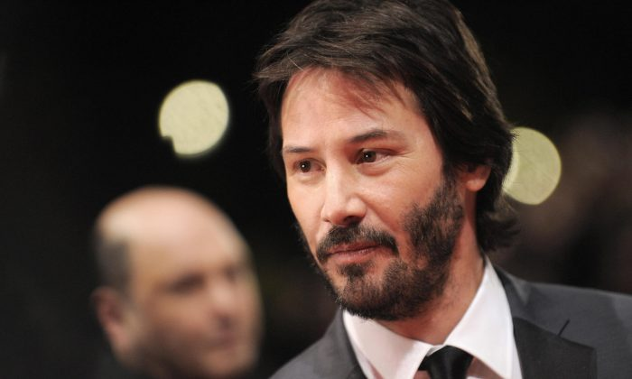 """US actor Keanu Reeves poses for photographers on the red carpet ahead of the premiere of the film """"The Private Lives of Pippa Lee"""" in Berlin, Feb. 9, 2009. (Axel Schmidt/AFP/Getty Images)"""
