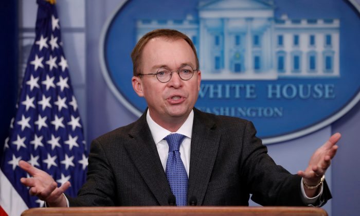 White House budget director Mick Mulvaney gestures as he holds a press briefing at the White House in Washington on Jan. 19, 2018. (Kevin Lamarque/Reuters)