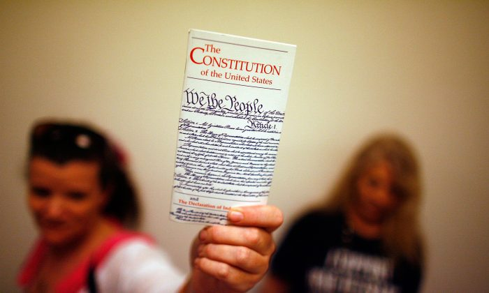 Lisa Petry holds up a copy of the U.S. Constitution on Capitol Hill in Washington on July 25, 2008. (Chip Somodevilla/Getty Images)