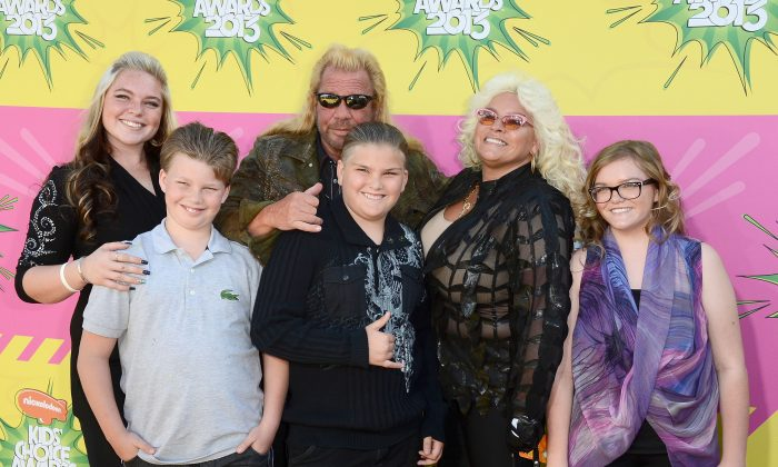TV personality Duane 'Dog' Chapman (C) and family arrive at Nickelodeon's 26th Annual Kids' Choice Awards at USC Galen Center in Los Angeles, California, on March 23, 2013.  (Photo by Frazer Harrison/Getty Images)