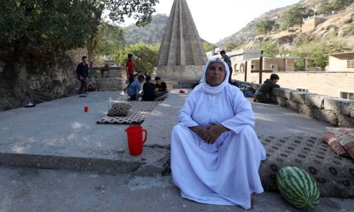 An Iraqi Yazidi woman is pictured at Lalish temple in a valley near Dohuk, northwest of Baghdad, on October 5, 2018. (Safin Hamed/AFP/Getty Images)