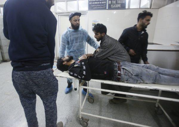 Kashmiri men wheel in civilian
