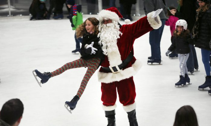 Ice skaters are joined by a man dressed as Santa Claus at The Rink at Rockefeller Center on December 14, 2018 in New York City. (Spencer Platt/Getty Images)