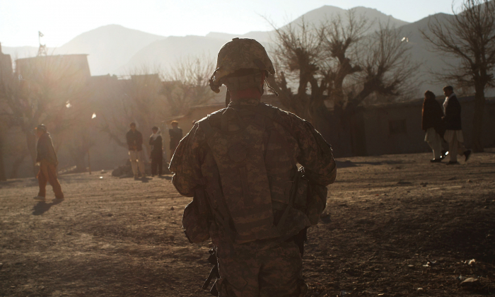 US Army soldiers enter the village of Pushtay in Afghanistan on Jan. 9, 2010. (Spencer Platt/Getty Images)