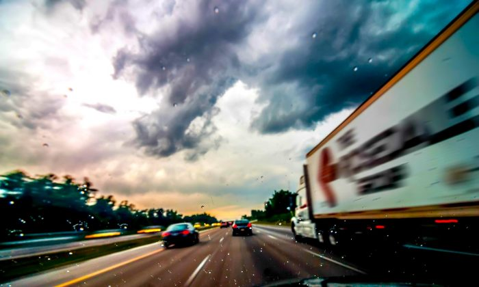 Undated file photo of a truck on a highway in rainy conditions. A Facebook post detailing the actions of Brendan Foote, an Australian truck driver who guided a couple to safety in a downpour on Dec. 13, 2018, in Queensland, Australia, has gone viral. (CC0/Pixabay)
