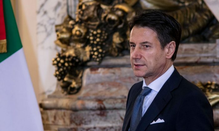 Prime Minister of Italy Giuseppe Conte gestures during a meeting between the president of Argentina and the Prime Minister of Italy ahead of Argentina G20 Leaders' Summit 2018 on November 29, 2018 in Buenos Aires, Argentina. (Photo by Ricardo Ceppi/Getty Images)