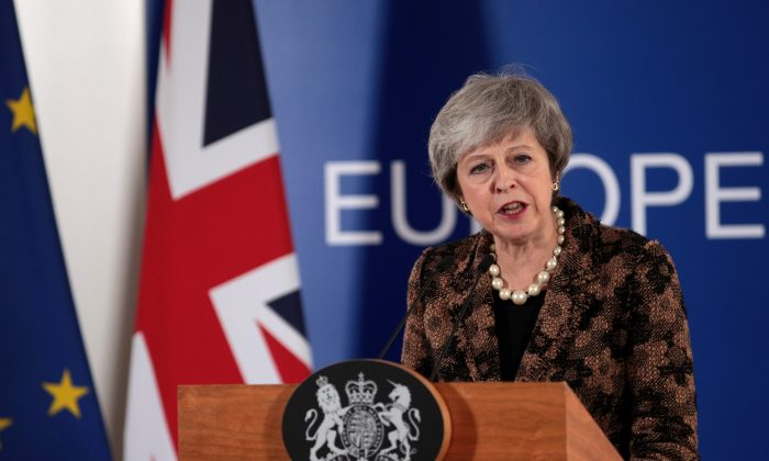 British Prime Minister Theresa May holds a press conference at the European Council during the two-day EU summit on Dec. 14, 2018, in Brussels, Belgium. May returned to the EU summit to secure greater assurances on the temporary nature of the Irish Backstop, in turn hoping to persuade MPs to vote her Brexit Deal through Parliament in the coming weeks.  (Dan Kitwood/Getty Images)