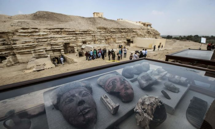 Monuments are displayed during a new discovery made by an Egyptian archaeological mission through excavation work at an area located on the stony edge of King Userkaf pyramid complex in Saqqara Necropolis, south of the capital Cairo, on Nov. 10, 2018. (Khaled Desouki/AFP/Getty Images)