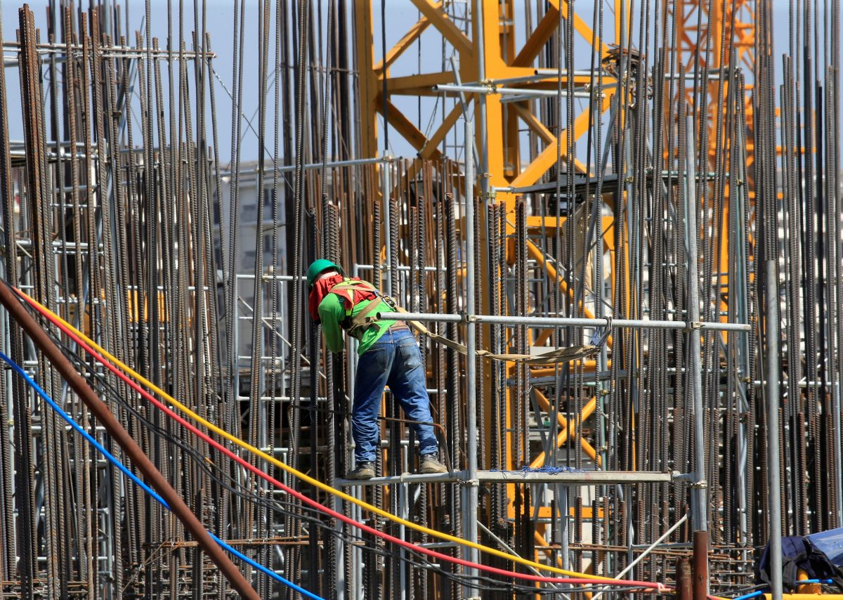 A worker installs steel rods at a construction site in Paranaque city, metro Manila, Philippines