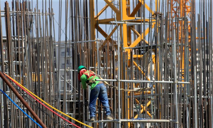 A worker installs steel rods at a construction site in Paranaque city, metro Manila, Philippines, on May 29, 2018. (Romeo Ranoco/Reuters)