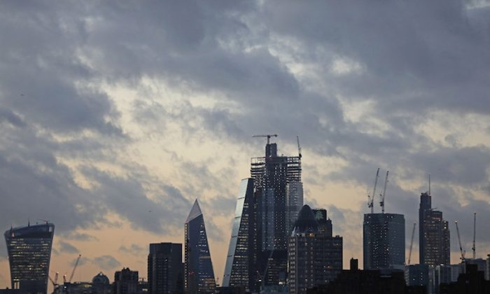 The sun sets behind the Canary Wharf financial district of London, Britain, on Dec. 7, 2018. (Simon Dawson/Reuters)