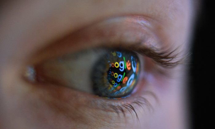 An image of the Google logo is reflected on the eye of a man in London on Aug. 9, 2017. (Leon Neal/Getty Images)