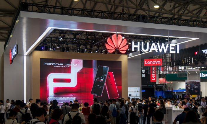 People gather at a Huawei stand during the Consumer Electronics Show (CES) Asia in Shanghai on June 13, 2018. (AFP/Getty Images)