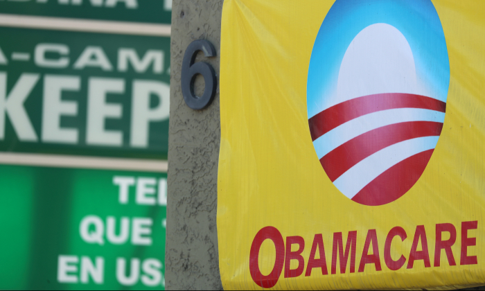 A sign on an insurance store advertises Obamacare in San Ysidro, San Diego, California, U.S., Oct. 26, 2017. (Mike Blake/Reuters)