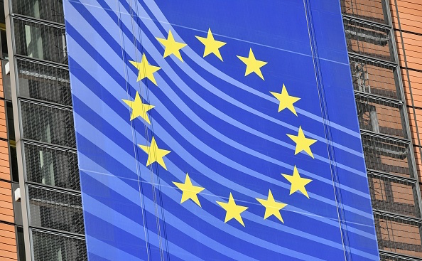 A baner displaying the European flag adorns the facade of the European Commission in Brussels on Nov. 14, 2018. (Photo by Emmanuel DUNAND / AFP)        (Photo credit should read EMMANUEL DUNAND/AFP/Getty Images)