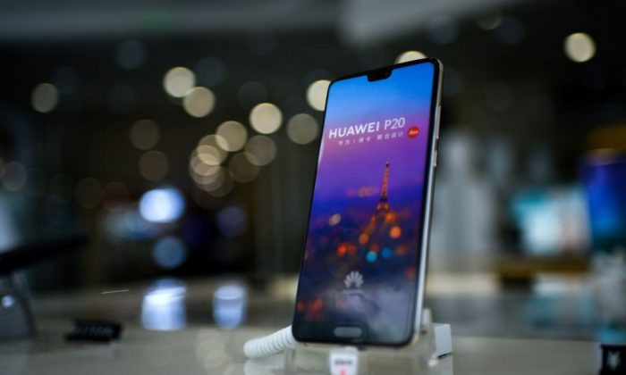 A Huawei smartphone is displayed at a Huawei store in Beijing on Aug. 7, 2018. (Wang Zhao/AFP/Getty Images)