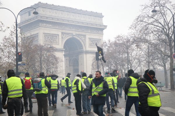 Yellow vest protesters gather in Paris on Dec. 1, 2018. (David Vives/The Epoch Times)