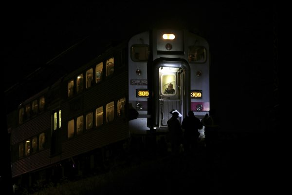 Passengers sit on a train