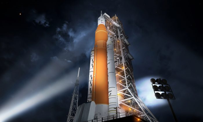 Artist concept of the SLS Block 1 configuration. For the first time in almost 40 years, a NASA human-rated rocket has completed all steps needed to clear a critical design review. The agency's Space Launch System (SLS) is the first vehicle designed to meet the challenges of the journey to Mars and the first exploration class rocket since the Saturn V. (NASA/MSFC)