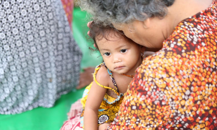 An unidentified woman holding a baby.  (Cambodian Children's Trust)