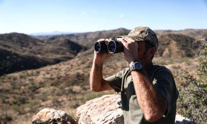 Arizona Border Recon founder Tim Foley surveys the U.S.–Mexico border south of Arivaca, Ariz., on Dec. 8, 2018. (Charlotte Cuthbertson/The Epoch Times)