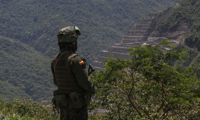 A Colombian soldier stands guard in a file photo. Six people were killed in the remote town of Mapiripán on Dec. 17, 2018. (Joaquin Sarmiento/AFP/Getty Images)