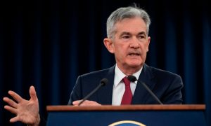 FED Raises Rates, Signals 2 More Hikes Next Year