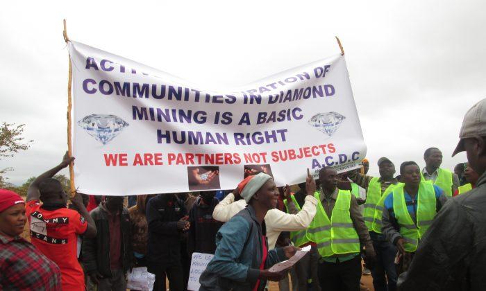 People in Marange, Zimbabwe demonstrate against diamond mining companies. (James Mupfumi)