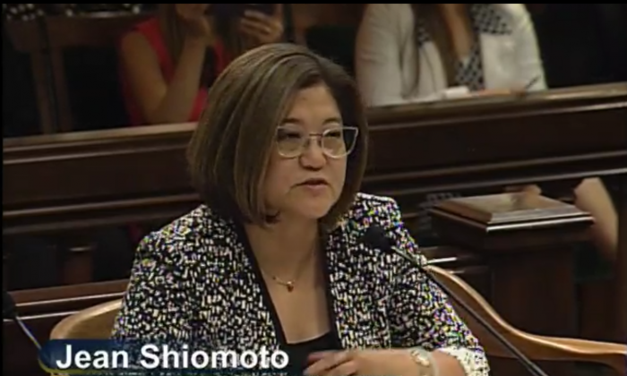 The California DMV Director Jean Shiomoto appeared at an Assembly hearing on Aug. 8, 2018 (Screenshot/California State Assembly Media Archives)